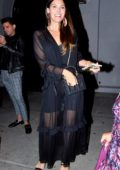 Ali Landry stops for photos wearing a black sheer dress while leaving Craig's in West Hollywood, Los Angeles