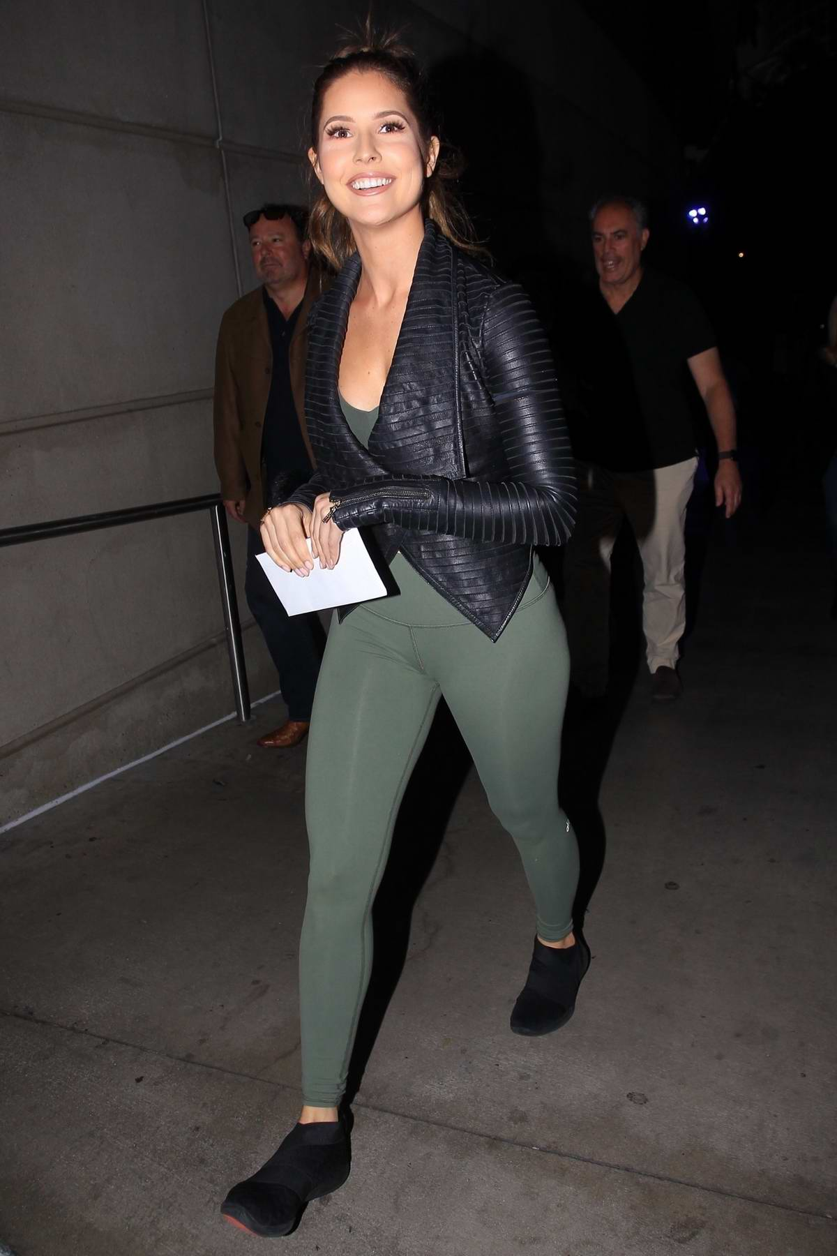 Amanda Cerny spotted in a leather jacket and green leggings as she heads to the Staples Center in Los Angeles