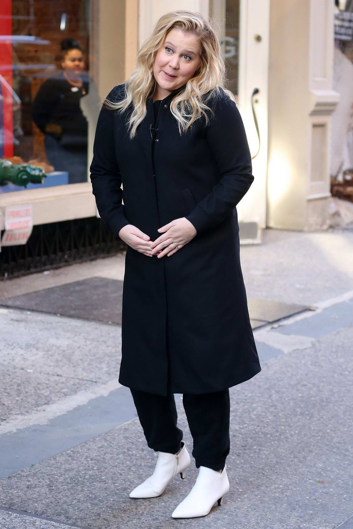 Amy Schumer have some fun while on the set of a photoshoot in New York City