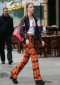 Anya Taylor-Joy wore orange plaid pants with black star-patched leather jacket over a graphic tank top while out in New York City