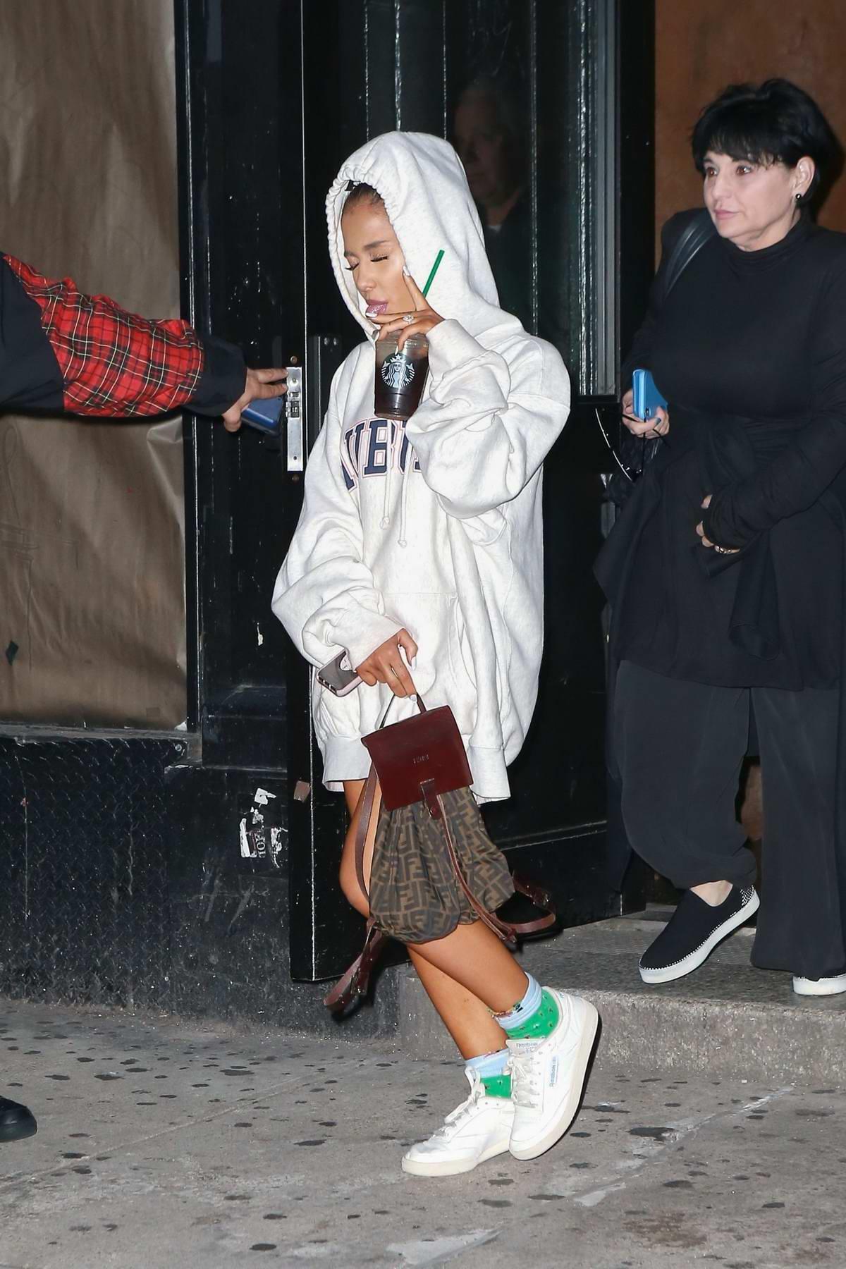 Ariana Grande Holds Onto Her Starbucks As She Leaves A