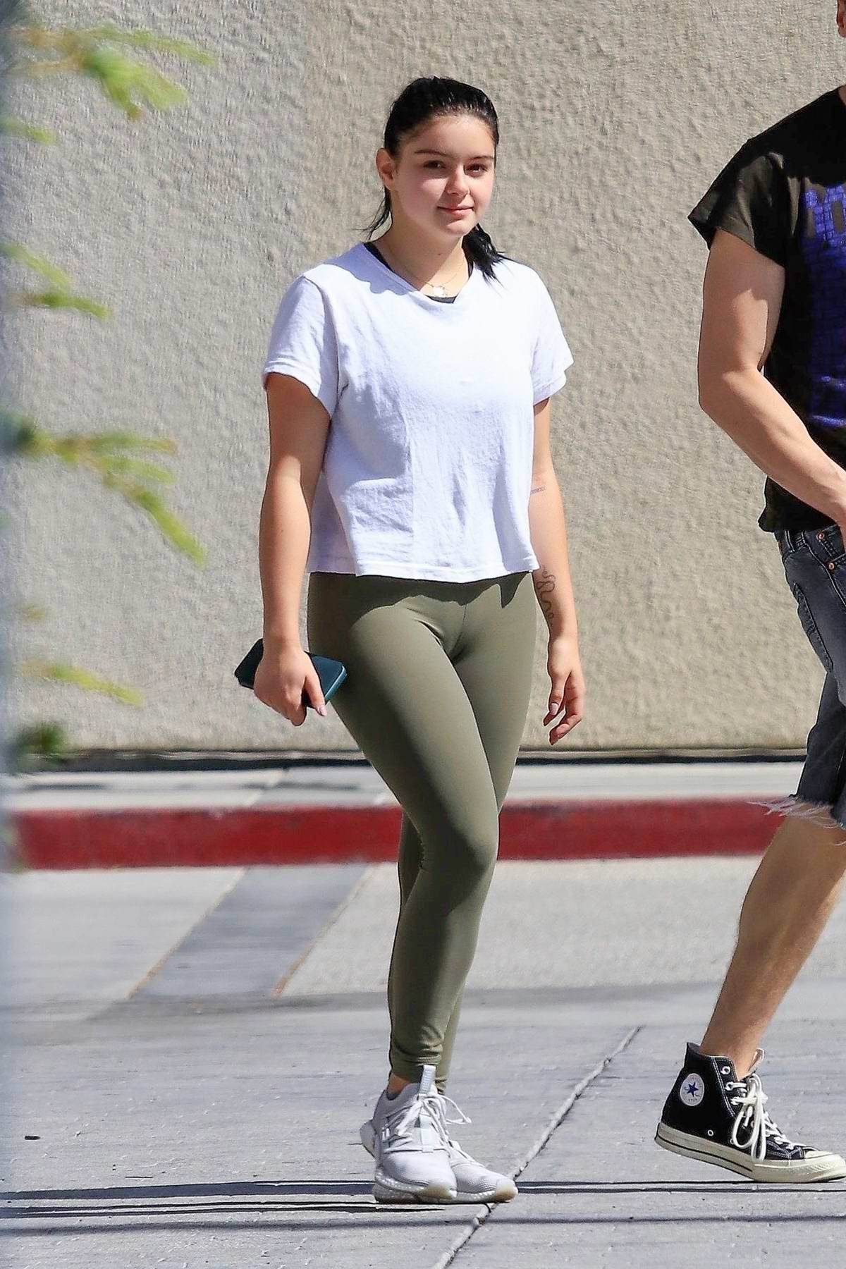 Ariel Winter spotted in a white tee, olive green leggings and Puma trainers as she leaves the gym in Los Angeles