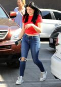 Ariel Winter wears a red crop top and jeans as she leaves Nine Zero One Salon in West Hollywood, Los Angeles