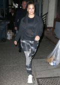 Ashley Graham rocks a patterned leggings with a black top and jacket as she walks back to her apartment in New York City