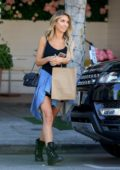 Audrina Patridge seen wearing a short black dress while filming a scene for 'The Hills' reality show at Fig & Olive in Los Angeles