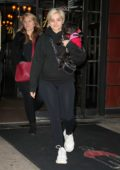 Bebe Rexha cradles her pup as she steps out makeup free, wearing a black sweatshirt and leggings in New York City