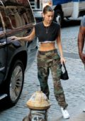 Bella Hadid flashes her toned abs as she steps out in a crop top and camo pants in New York City