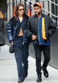 Bella Hadid is all smiles as she steps out for a romantic stroll with boyfriend The Weeknd in New York City