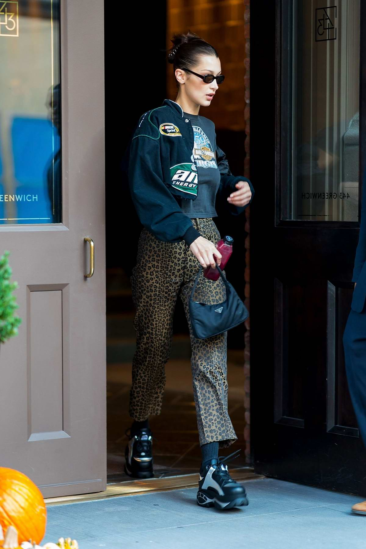 Bella Hadid rocks a cropped jacket and leopard print pants as she steps out in Tribeca in New York City