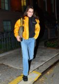 Bella Hadid smiles for the camera as she heads out to celebrate her birthday in New York City