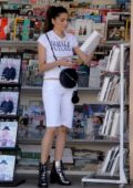 Blanca Blanco stops at the news stand in Malibu, California