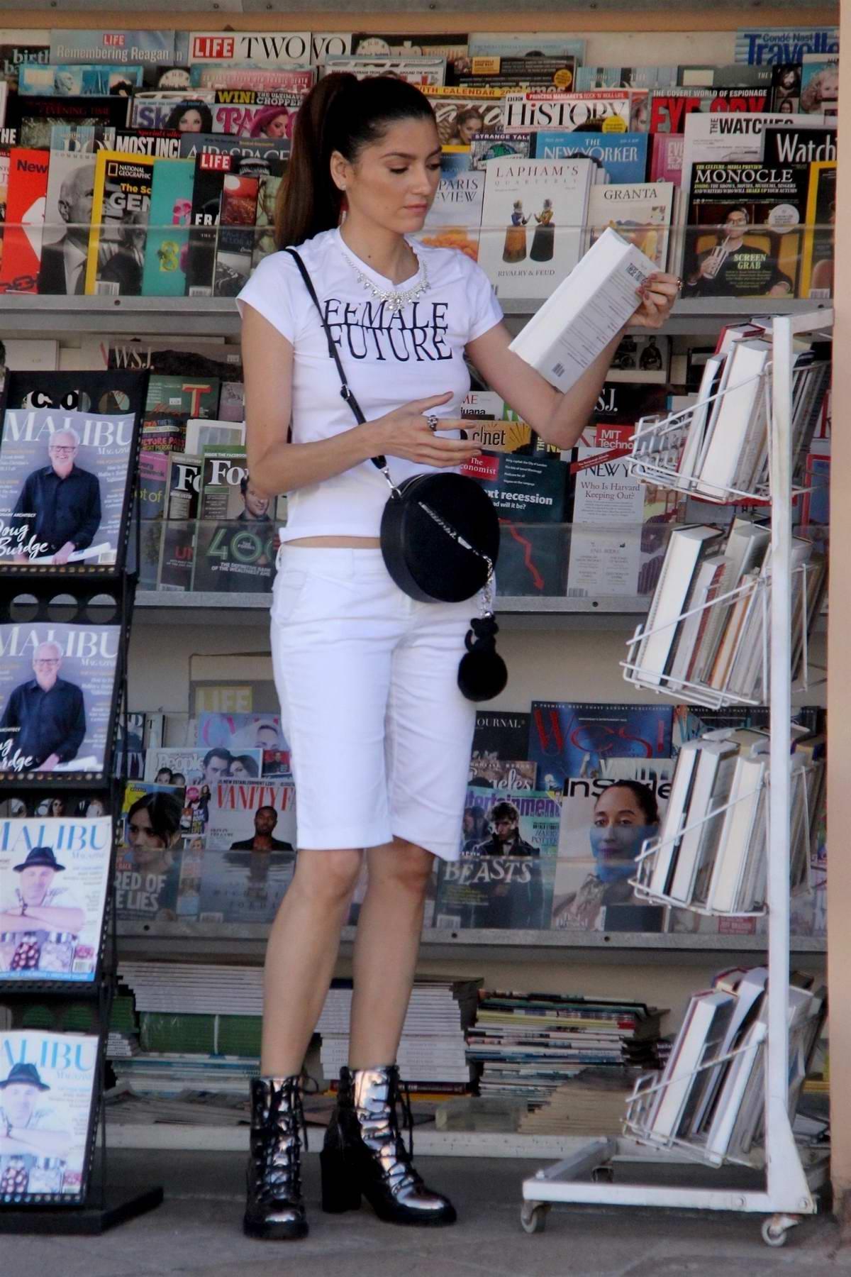 Blanca Blanco stops at the news stand in Malibu, California