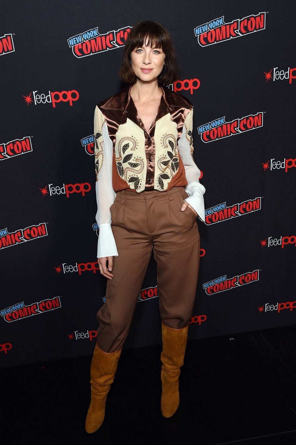 Caitriona Balfe attends 'Outlander' panel during New York Comic Con 2018 (NYCC 2018) at Javits Center in New York City