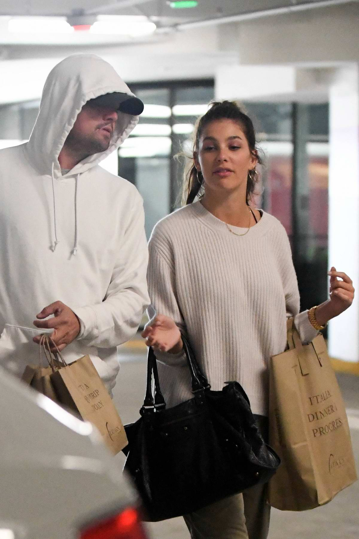 Camila Morrone and Leonardo DiCaprio picks up some groceries after dining at Eataly in Century City, California