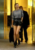 Candice Swanepoel looks stunning in a grey top and black leather shorts as she leaves after her fittings at the Victoria's Secret offices in New York City
