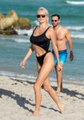 Caroline Vreeland rocks a black bikini as enjoys a beach day with a mystery man in Miami, Florida