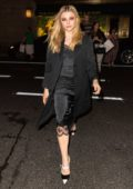 Chloe Grace Moretz seen wearing a black silk dress as she leaves Ralph Polo Bar in New York City