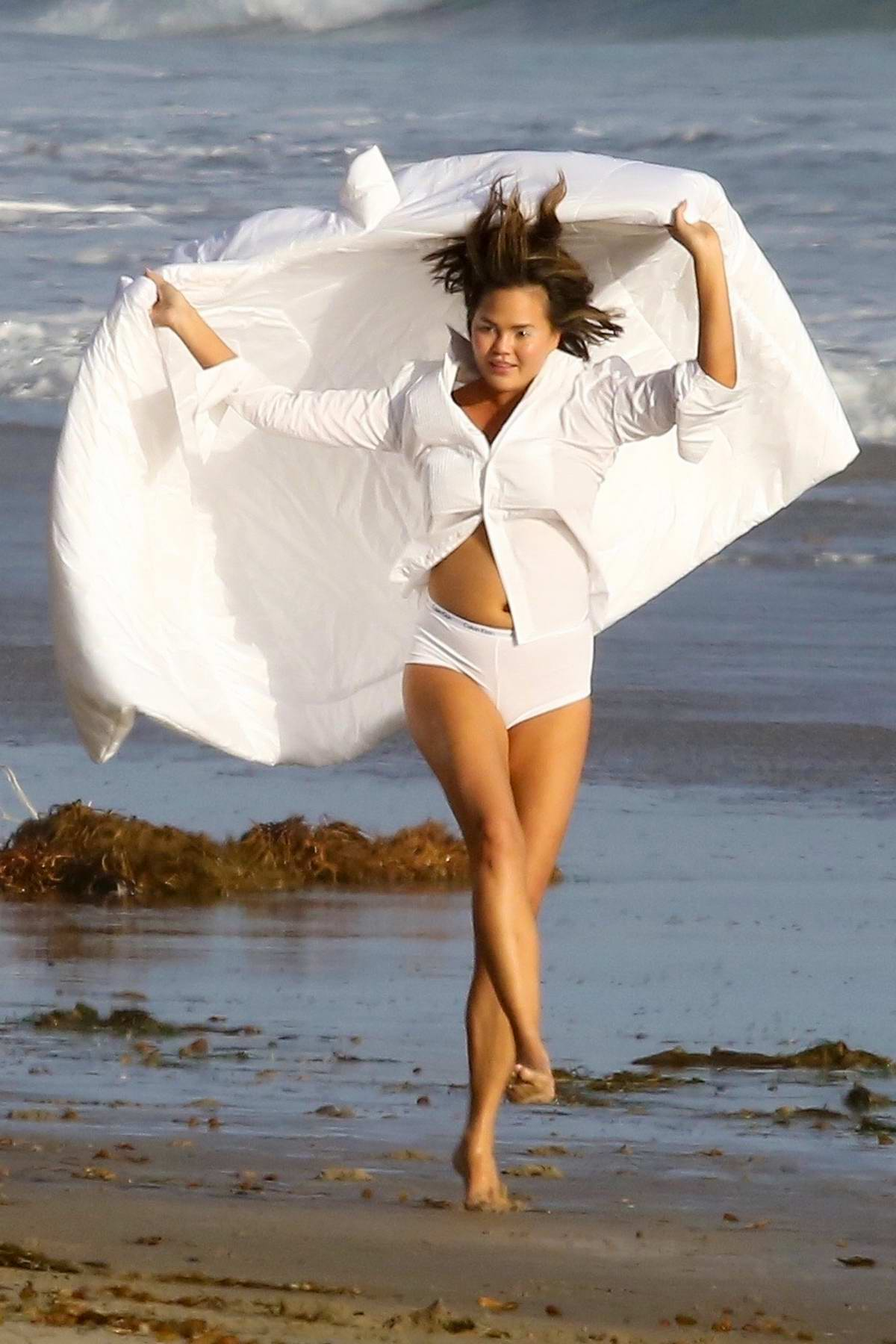 Chrissy Teigen spotted during a Calvin Klein photoshoot at the beach in Malibu, California