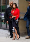 Chrissy Teigen steps out in a knotted red shirt with checkered skirt while promoting her new book Cravings: Hungry For More in New York City