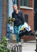 Claire Danes carrying a plant and two large shopping bags while out and about in New York City