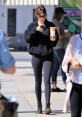 Dakota Johnson keeps it casual in a black sweatshirt and leggings during a coffee run to Alfreds in Los Angeles