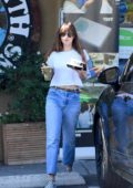 Dakota Johnson keeps it casual in a white t-shirt and jeans as she grabs lunch at Earthbar in Los Angeles