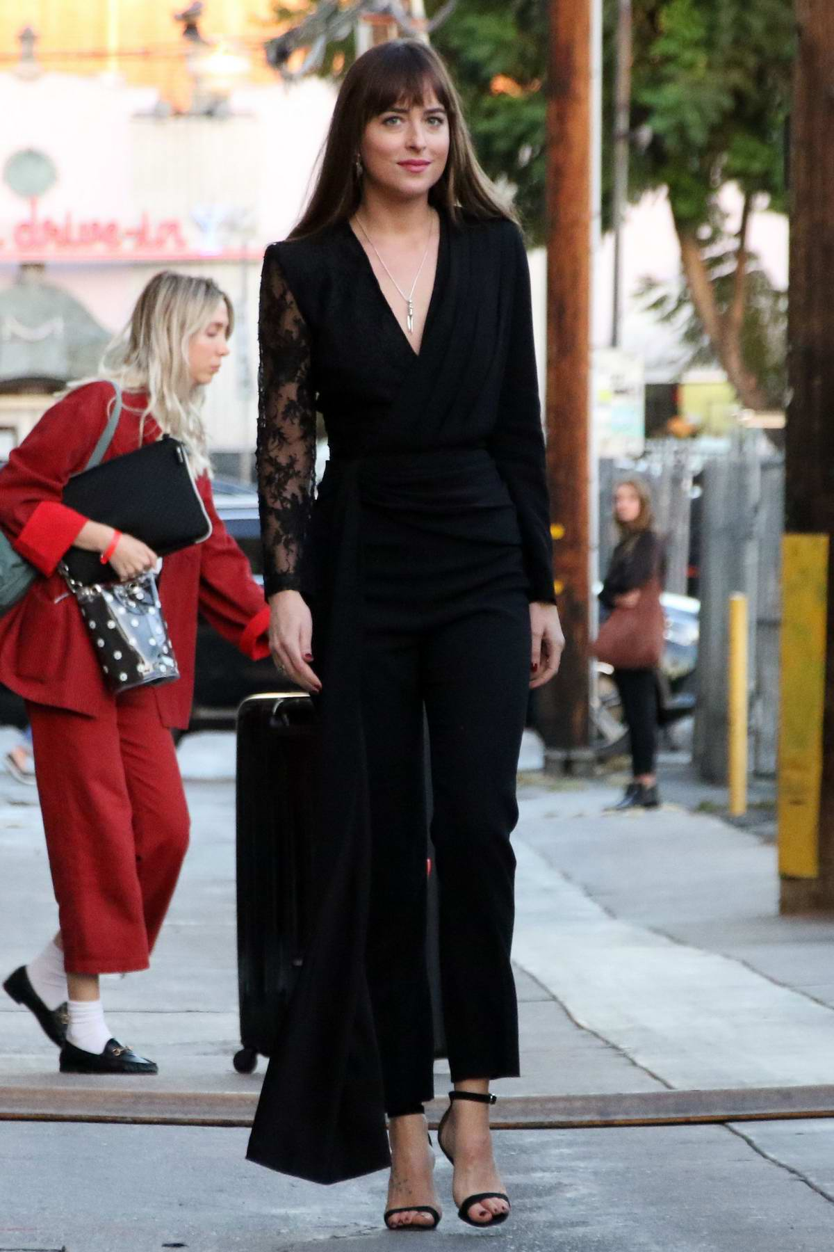 Dakota Johnson seen wearing a black outfit as she leaves after her appearance on 'Jimmy Kimmel Live!' in Hollywood, Los Angeles