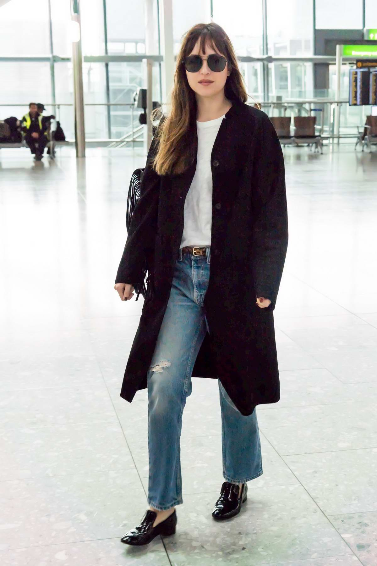 Dakota Johnson spotted at Heathrow Airport as she arrives to catch a flight out of London, UK