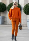 Devon Windsor stands out in an orange outfit while out in Paris, France