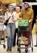 Elizabeth Olsen and Robbie Arnett enjoys some frozen yogurt while shopping groceries at Whole Foods in Los Angeles