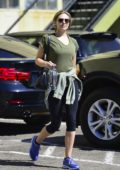 Elizabeth Olsen carries a bottled water and a jump rope as she leaves the gym in Los Angeles