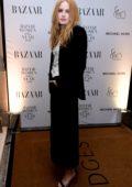 Ellie Bamber attends the Harper's Bazaar Women of the Year Awards 2018 in London, UK