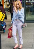 Ellie Bamber fly into Heathrow airport in London, UK