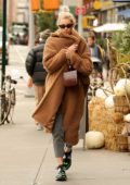 Elsa Hosk looks warm and cozy in a brown sherpa coat while out in New York City