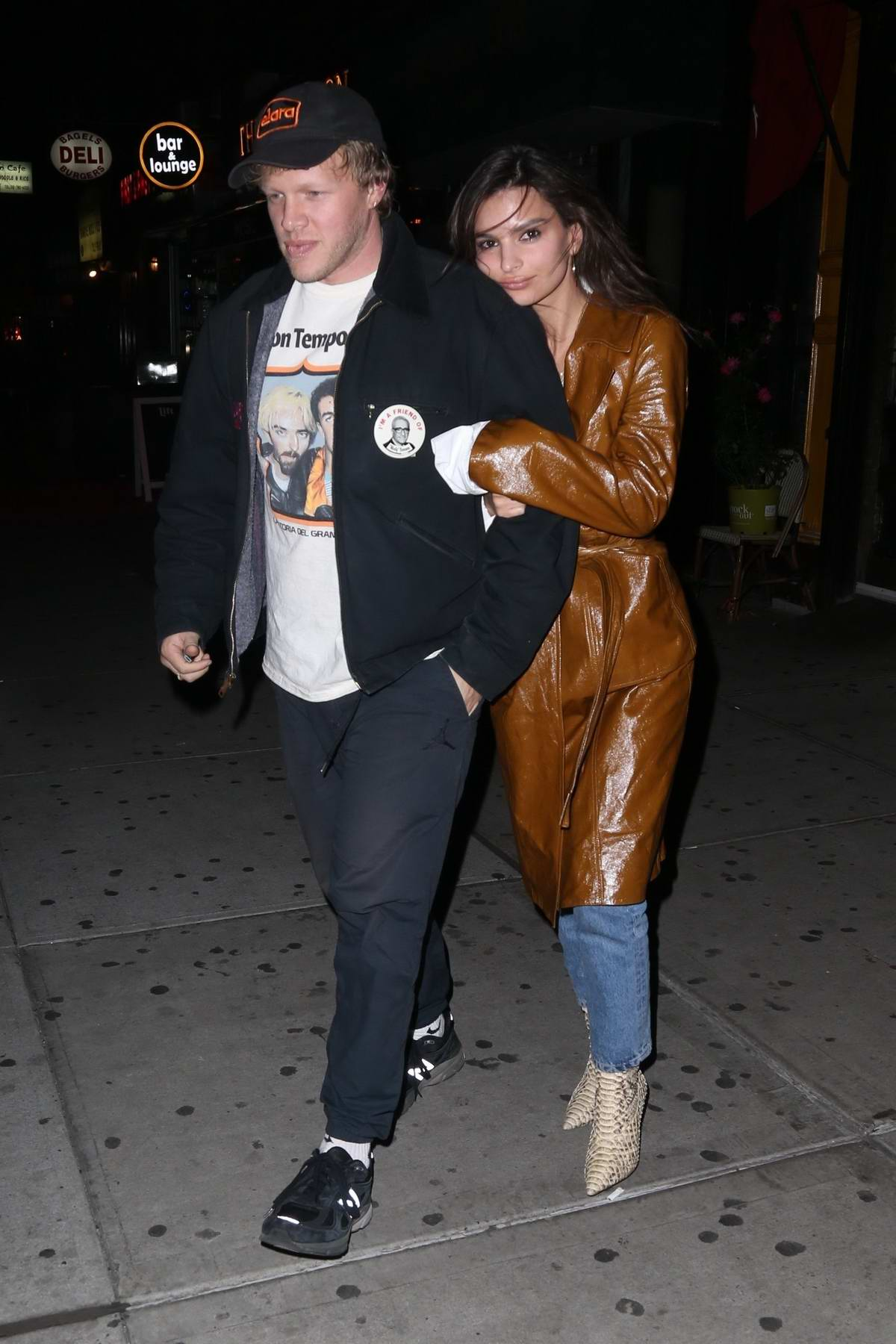 Emily Ratajkowski cuddles up to husband Sebastian Bear-McClard after dinner with friends during a night out in New York City
