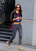 Emily Ratajkowski steps out in a graphic crop top and jeans while visiting a friend in Soho, New York City