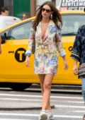Emily Ratajkowski wears a floral print blazer and sneakers while out and about with a friend in New York City