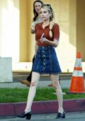 Emma Roberts looks cute in a short denim skirt and brown top as she heads for an early dinner with a friend in Los Feliz, California