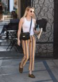 Emma Roberts wears white tank top and colorful striped pants as she leaves the 901 salon in West Hollywood, Los Angeles