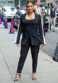 Eva Longoria poses for the camera as she arrives at The Late Show with Stephen Colbert in New York City