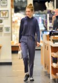 Gigi Hadid rocks a blue hoodie with a pair of matching blue trousers while shopping at gem store in New York City