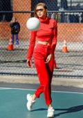 Gigi Hadid seen wearing a red outfit while playing volleyball on the set of a photoshoot in New York City