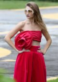 Gigi Hadid spotted in red dress after arriving on a helicopter for the photoshoot in Rio, Brazil