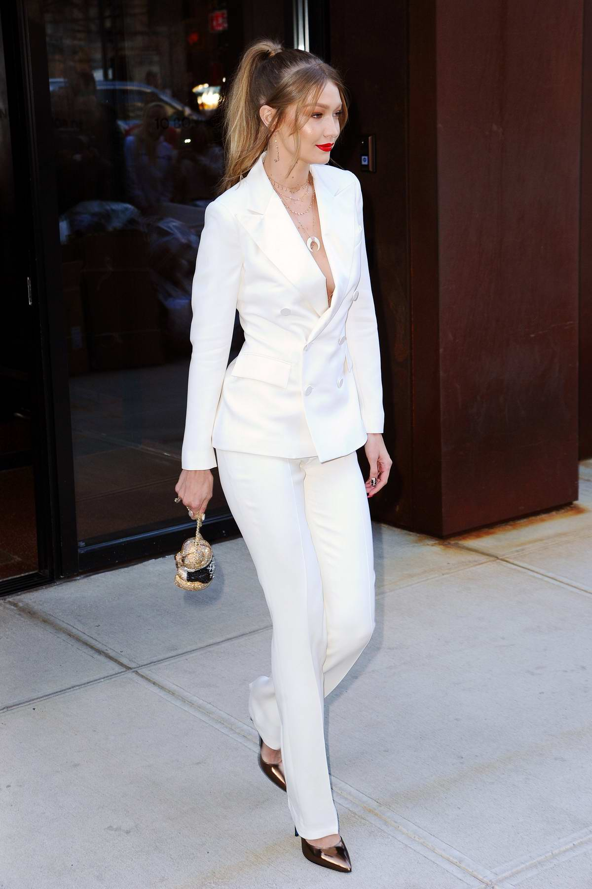 7fa1f3889 gigi hadid steps out in a pristine white pantsuit paired with ...