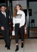 Gigi Hadid steps out in her 'Fashion Month Tour' sweatshirt as she heads to dinner at Raoul's in New York City