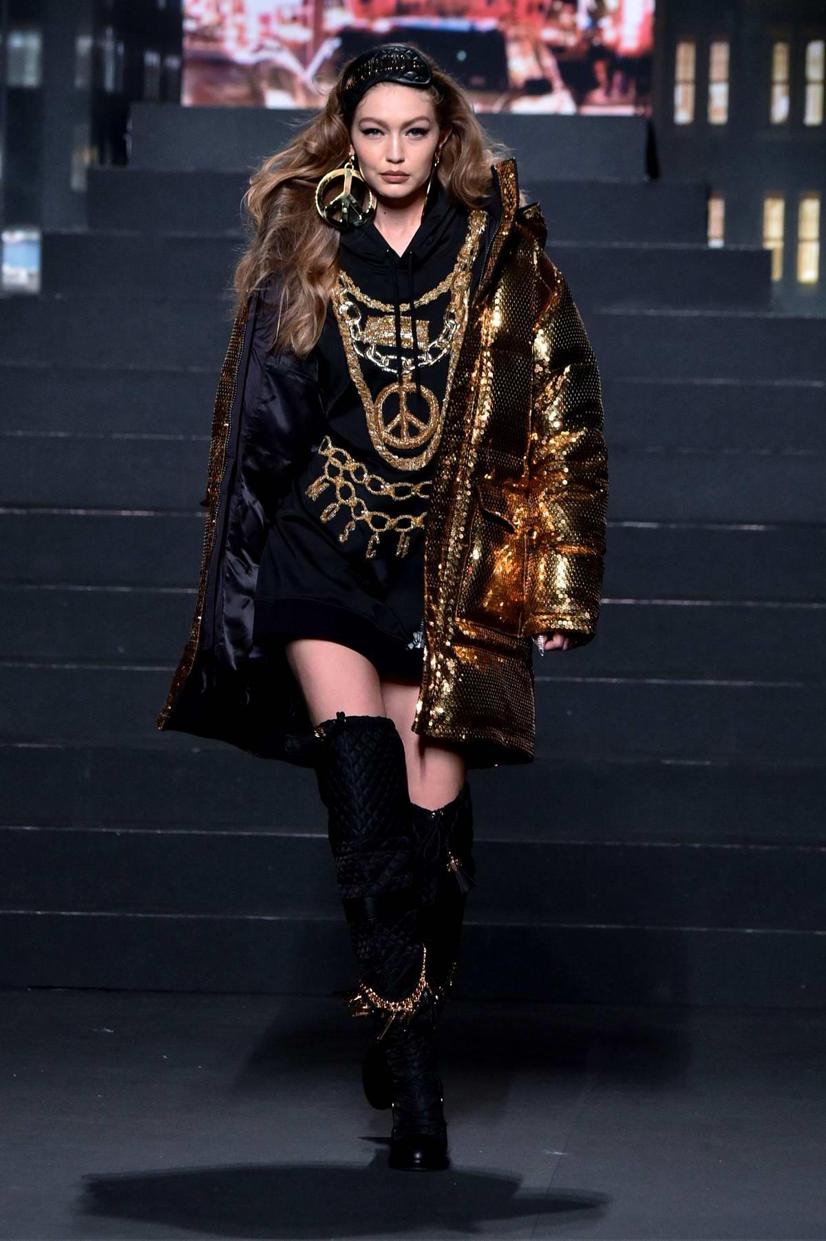 Gigi Hadid walks the runway during Moschino x H&M Fashion Show in New York City