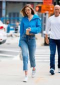 Gigi Hadid wore a cropped blue hoodie, jeans and Reebok sneakers as she stepped out to grab an iced coffee in New York City