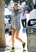 Hailey Baldwin wears a plaid blazer and skirt with a hoodie as she grabs breakfast with Justin Bieber at Joan's On Third in Studio City, Los Angeles