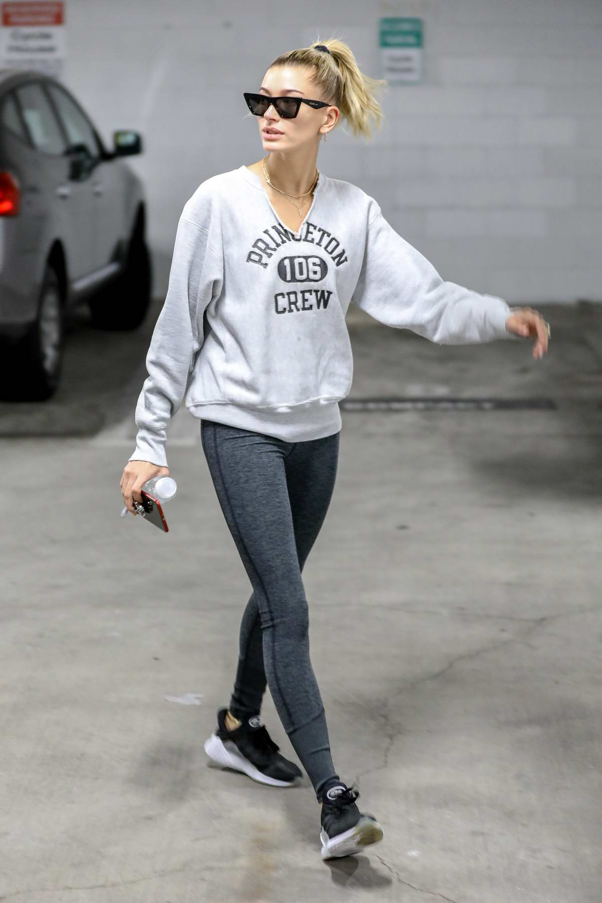 Hailey Baldwin wears a Princeton Crew sweatshirt and grey leggings as she arrives for a pilates class in Studio City, Los Angeles