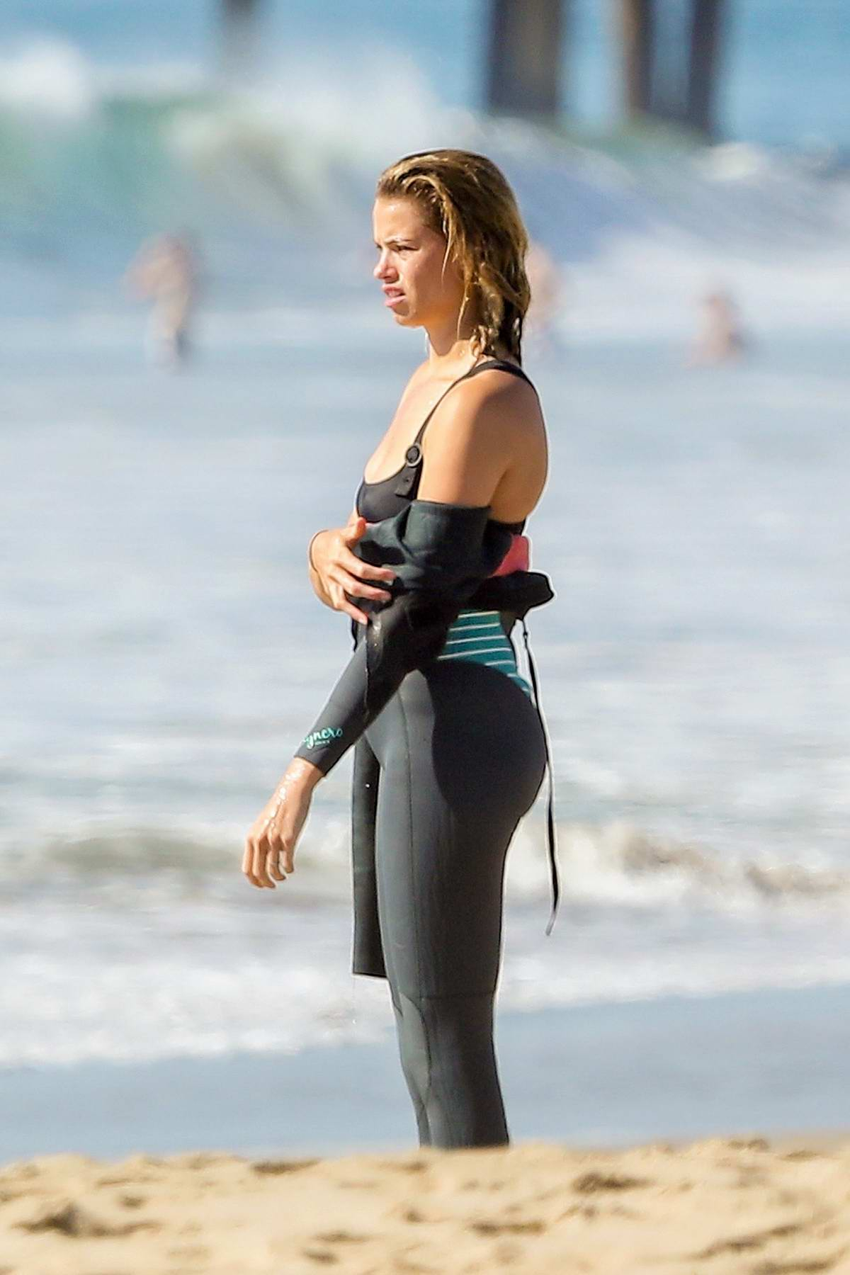 Hailey Clauson and boyfriend Jullien Harrera enjoys a day of surfing in Malibu, California